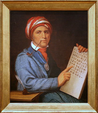 """Oil on canvas painting of Sequoyah with a tablet depicting his writing system for the Cherokee language"""